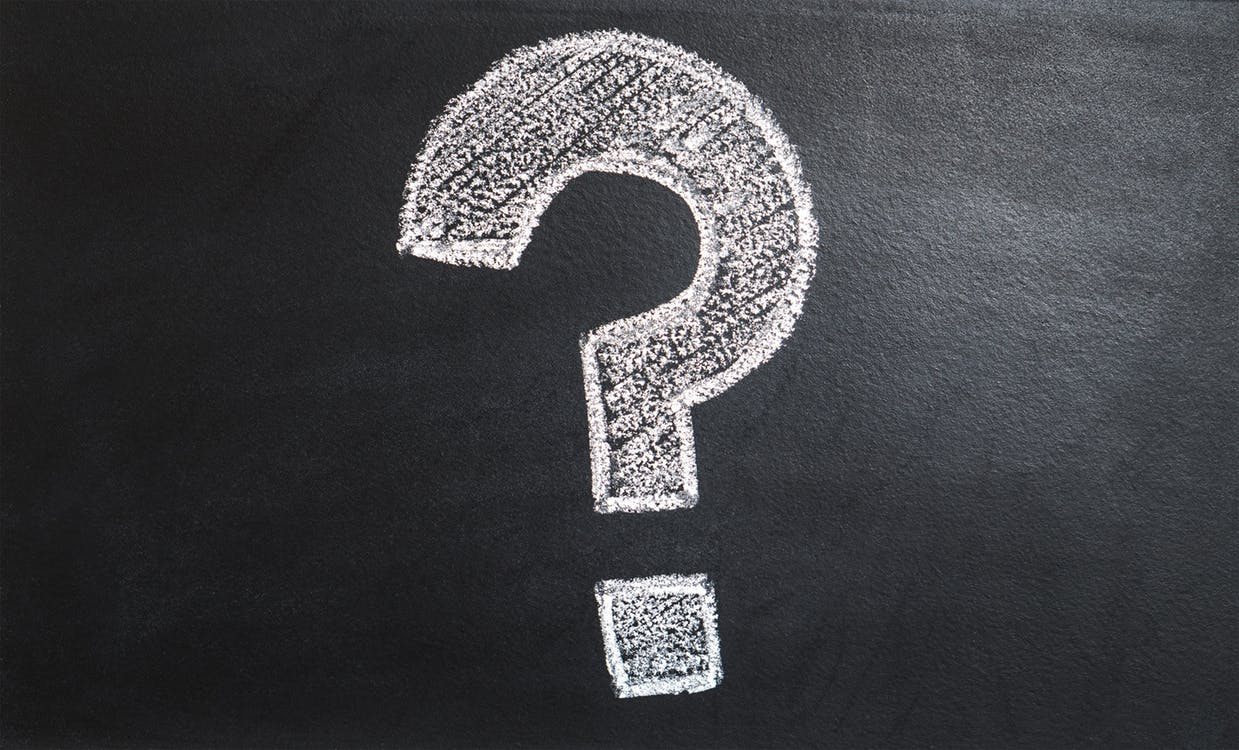 White question mark on blackboard. Photo: Pexels