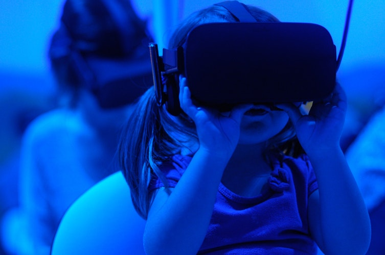 Girl wearing virtual reality goggles